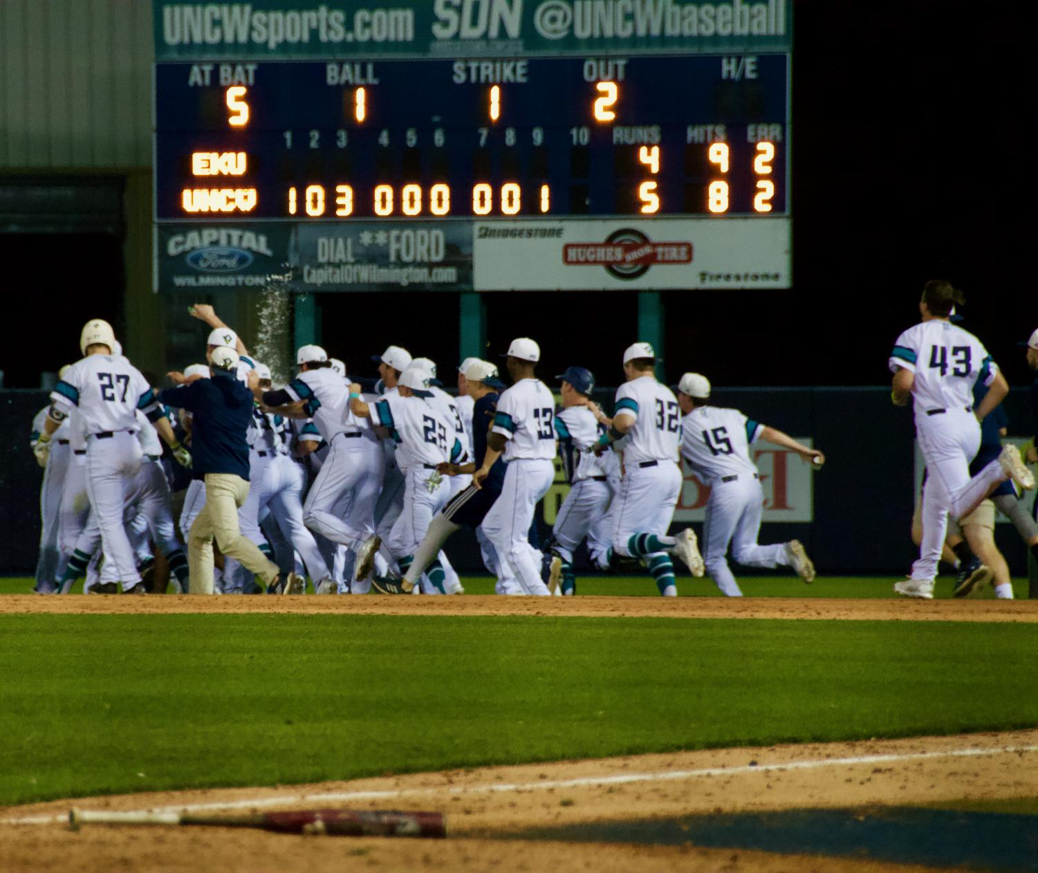 The Seahawks celebrate following their 5-4 walk-off victory over Eastern Kentucky on Friday