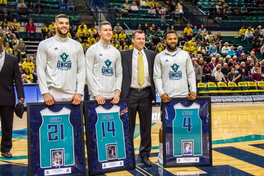 Coach McGrath stands proudly with his senior players Marcus Bryan, Nick Powell and Jordon Talley