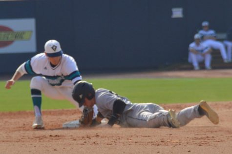 Second baseman no. 4 Doug Angeli attempts to tag out a Wofford runner