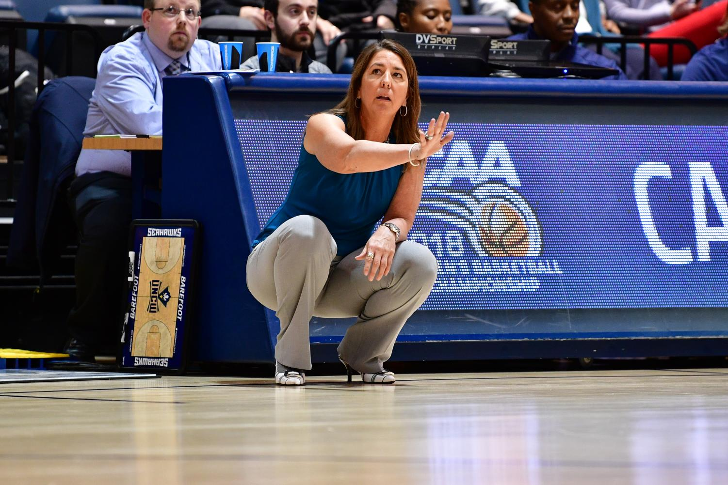 Karen Barefoot calls out signals to her team in a UNCW women's basketball game during the 2017-2018 season.
