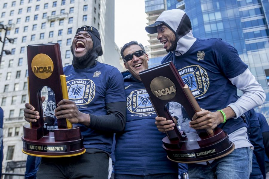 Villanova%27s+Eric+Paschall%2C+left%2C+head+coach+Jay+Wright%2C+center%2C+and+Mikal+Bridges%2C+right%2C+celebrate+as+they+show+off+the+NCAA+Tournament+and+Eastern+Regional+Trophies+to+the+massive+crowd+gathered+for+the+NCCA+Champions+Parade+at+Dilworth+Park+in+Philadelphia+on+Thursday+April+5%2C+2018.