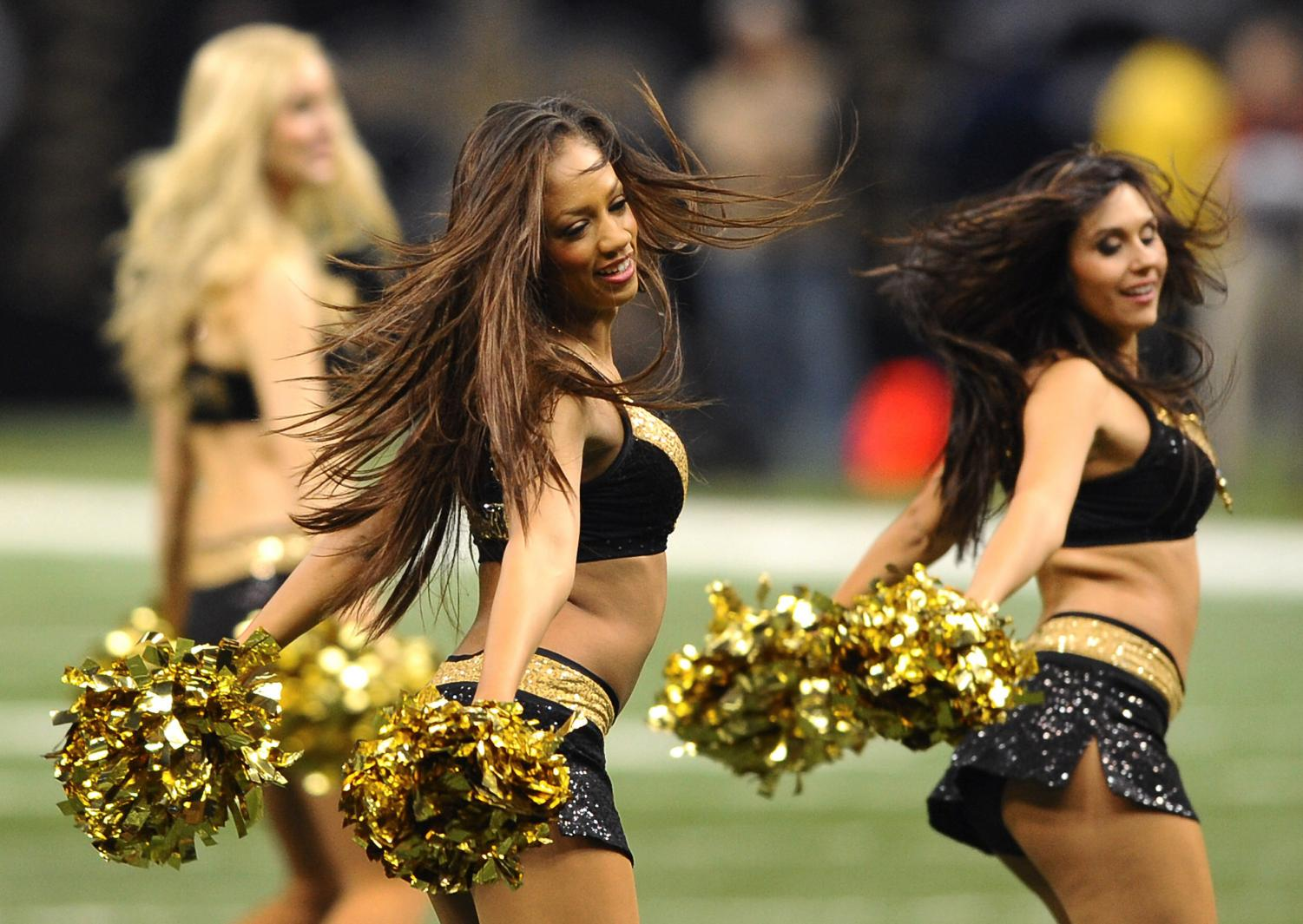 New Orleans Saints' cheerleaders cheer at a football game between the New Orleans Saints and the Carolina Panthers in Louisiana. (Jeff Siner/Charlotte Observer/MCT)