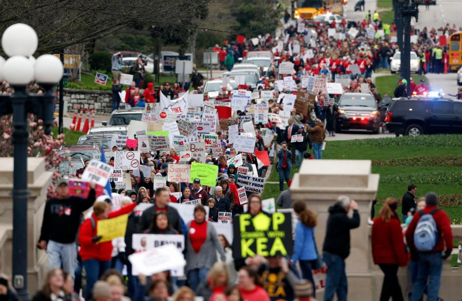 Thousands of Kentucky school teachers marched Monday, April 2, 2018 from the Kentucky Education Association's headquarters to the State Capitol in Frankfort, Ky. to protest legislative changes to their pensions and education cuts. Public schools in all 120 Kentucky counties were closed Monday, either to join in the protest or because of spring break.