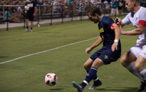 No. 10 Phillip Goodrum attempts to keep the ball in play