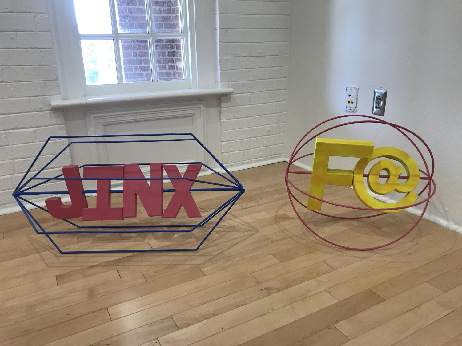 UNCW student Jonny Harris created his two sculptures, Pick Me Up JINX and Please Touch F@, out of steel, cardboard and spray paint.