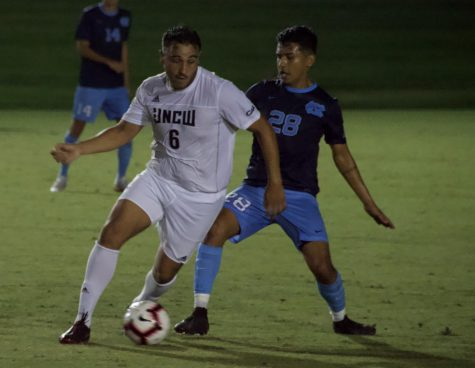 No. 6 David Lozano squares off with North Carolina's Raul Aguilera (28)