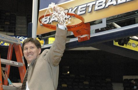 Former UNCW coach Brad Brownell cuts down the nets after winning the 2006 CAA tournament. It was the second conference title in Brownell's four-year tenure in the Port City.
