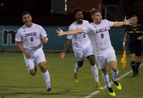 No. 9 Emil Elveroth celebrates after scoring his second goal in 77 seconds along with no. 3 Jamil Gracia and no. 6 David Lozano
