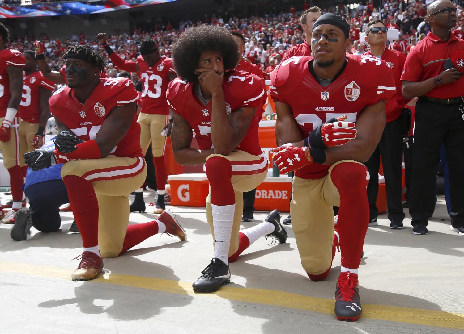 From left, The San Francisco 49ers' Eli Harold (58), Colin Kaepernick (7) and Eric Reid (35) kneel during the national anthem before their a game against the Dallas Cowboys on October 2, 2016, at Levi's Stadium in Santa Clara, Calif. (Nhat V. Meyer/Bay Area News Group/TNS)