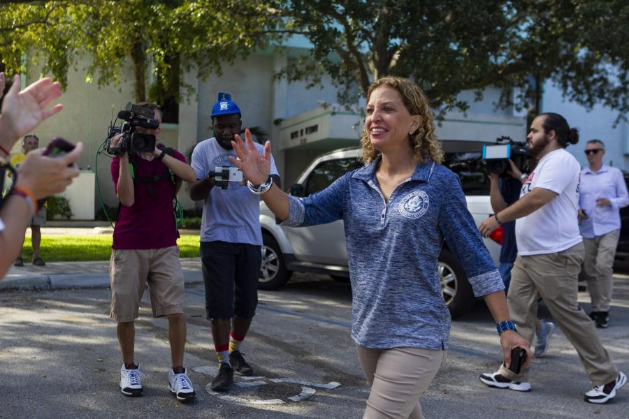 """Congresswoman Debbie Wasserman Schultz greets volunteers outside the Hollywood Branch Library before early voting on Friday, Oct. 26, 2018. Wasserman Schultz, whose staff received a suspected mail bomb, said she was hopeful law enforcement would """"catch this bastard."""""""