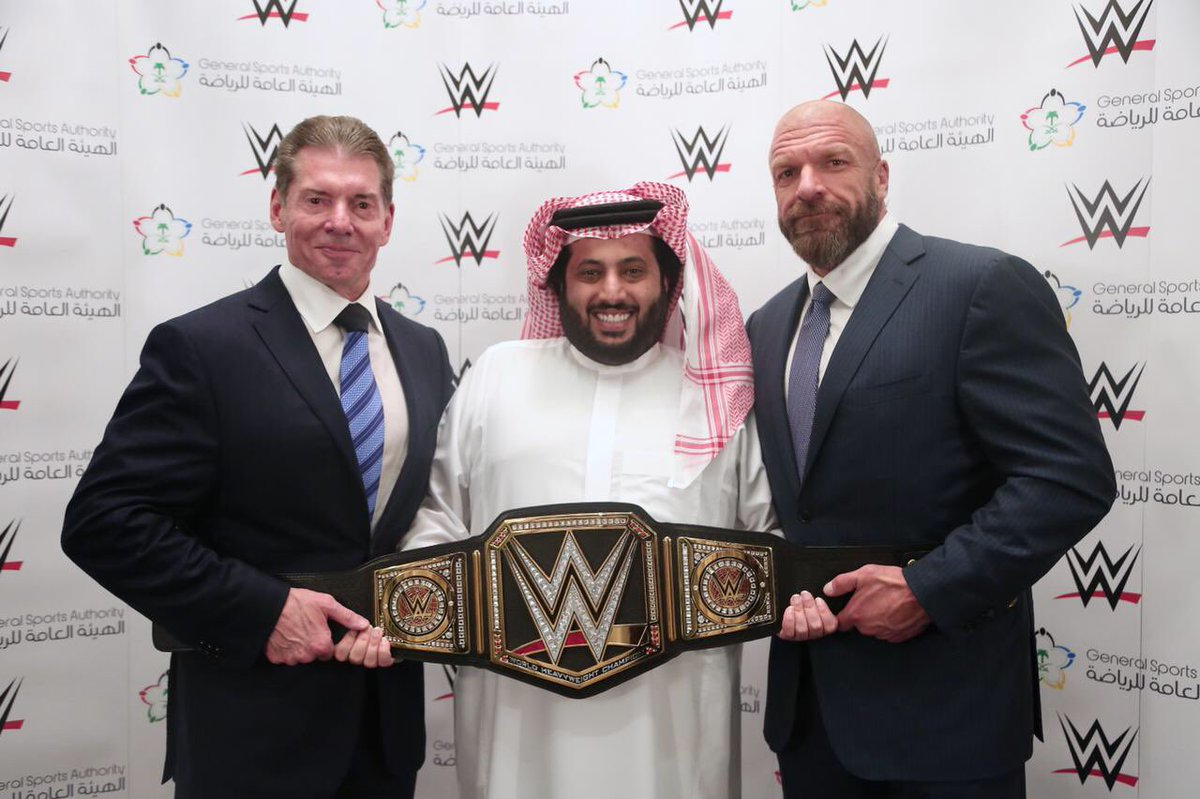 Pictured from left to right are: WWE Chairman and CEO Vince McMahon, Turki bin Abdel Muhsin Al-Asheik of Saudi Arabia's General Sports Authority, and Executive Vice President of Talent, Live Events and Creative of WWE Paul