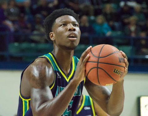 Devontae Cacok (15) attempts a free throw during UNCW's matchup against East Carolina on Nov. 27, 2018.
