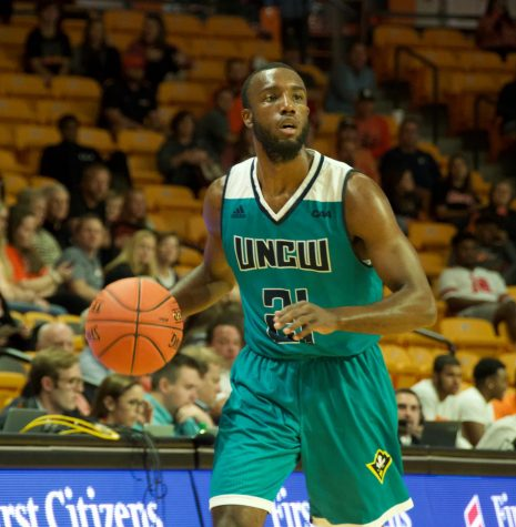 Ty Taylor (21) during UNCW's season opener against Campbell.