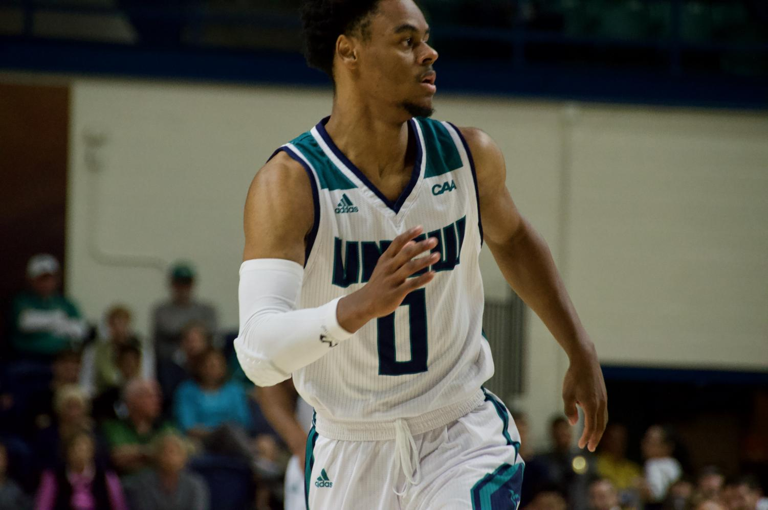 Ty Gadsden (10) tries to get open during UNCW's Tuesday night game v.s. UNC Greensboro