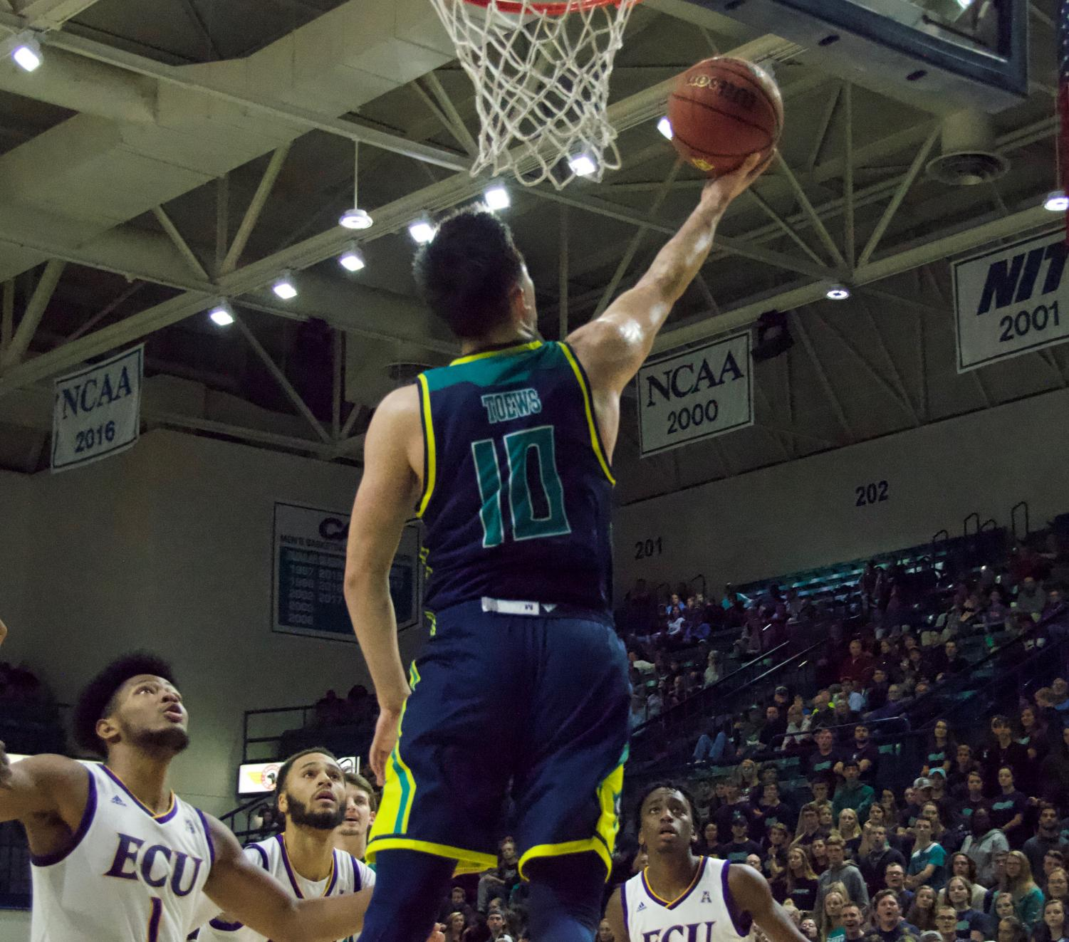 Kai Toews (10) shoots a layup during UNCW's contest against East Carolina on Nov. 27, 2018. The Seahawks won 95-86.