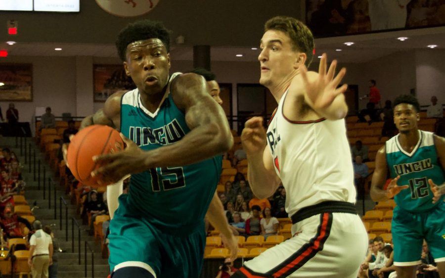 Devontae+Cacok+%2815%29+drives+through+the+lane+for+a+layup+during+UNCW%27s+season+opener+against+Campbell.+
