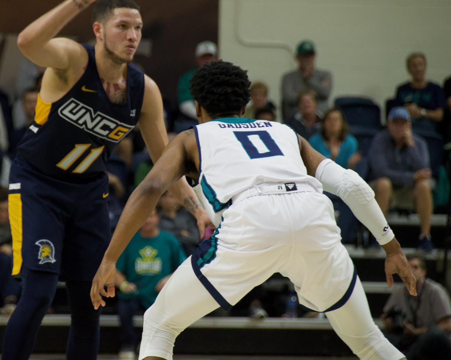 Ty Gadsden (0) gets set on defense during UNCW's Tuesday night game v.s. UNC Greensboro