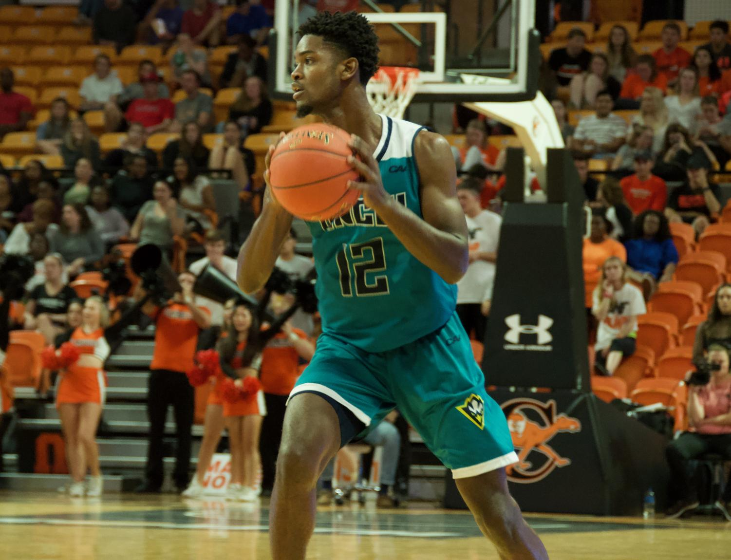 Jay Estime' (12) during UNCW's season opener against Campbell.