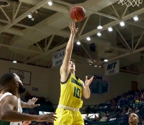 Kai Toews (10) throws up a floater during UNCW's exhibition against William Peace
