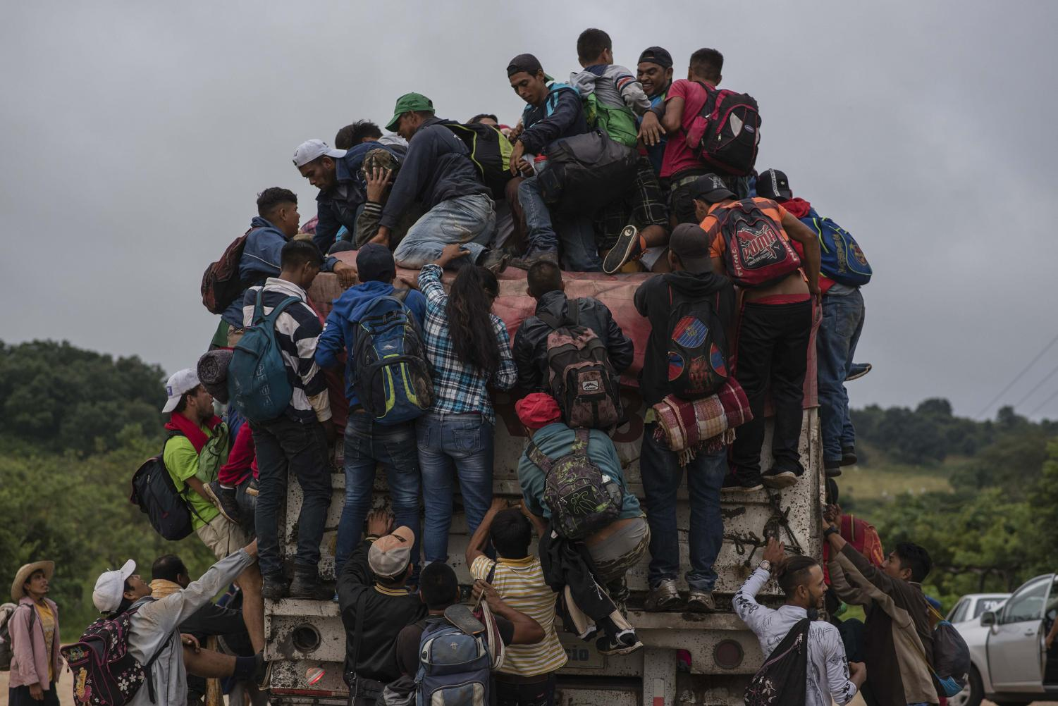 Migrants jump on a truck in order not to have to walk a part of their long way on Nov. 3, 2018 in Sayula, Veracruz, Mexico. Most of the migrants come from Honduras. They are currently on their way through Mexico towards the U.S. border.