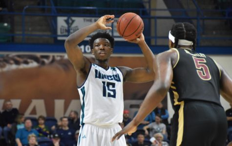 Seahawks downed by rival Cougars in conference opener
