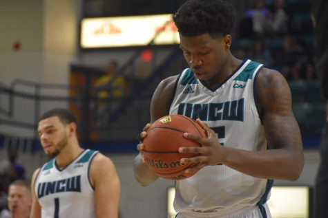 Devontae Cacok (15) preps for a free throw during UNCW's conference opener against College of Charleston on Dec. 29, 2018.