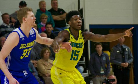 Devontae Cacok (15) calls for a pass during UNCW's home matchup with Delaware on Jan. 10, 2019.