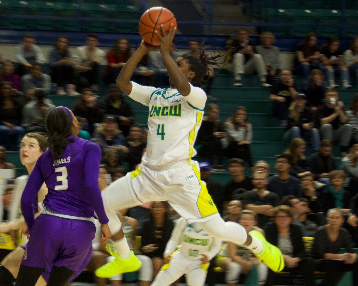Shrita Parker (4) hits a floater during UNCW's matchup with James Madison on Jan. 18, 2019.