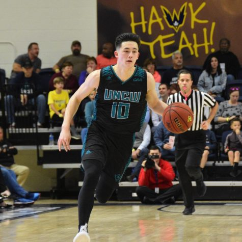 Kai Toews (10) drives up the court during UNCW's Thursday night matchup with William & Mary on Jan. 24, 2019.