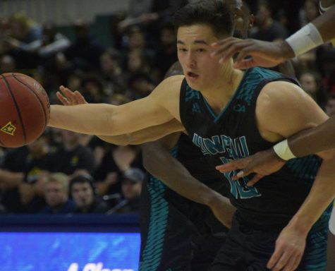 Kai Toews (10) battles through defenders during UNCW's matchup with William & Mary on Jan. 24, 2019.