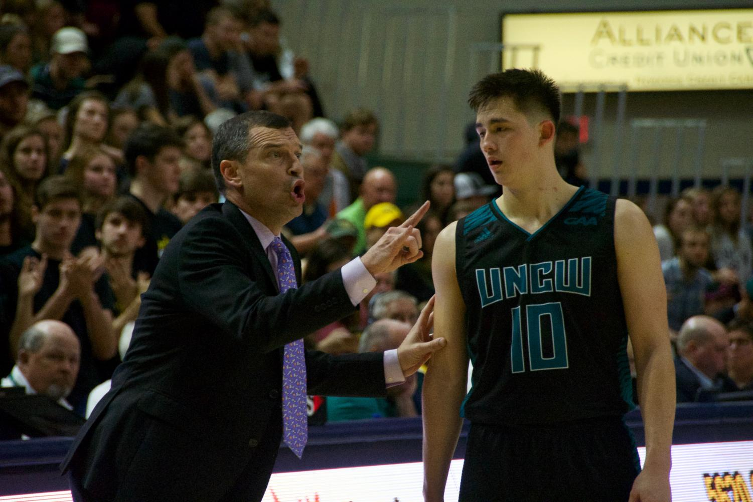 UNCW head coach C.B. McGrath directs the team during the Seahawks' 93-88 win over William & Mary on Jan. 24, 2019.