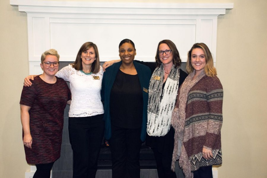 Director of Title IX & Clery Compliance Amber Resetar with members from the ollaboration for Assault Response & Education (CARE) office on campus.