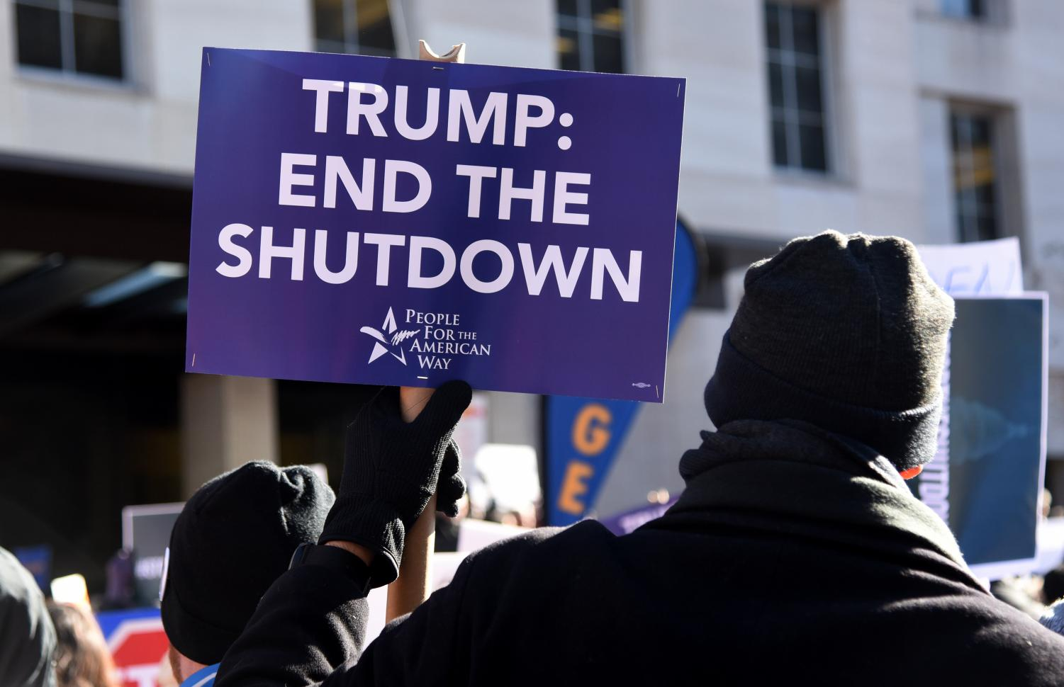On the 20th day of a partial government shutdown, furloughed federal workers, contractors and union representatives gathered before marching to the White House to demand that President Trump reopen the government on Jan. 10, 2019 in Washington, D.C.