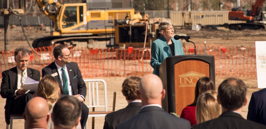 UNCW Vice Chancellor Pat Leonard, right, speaks to the crowd at a groundbreaking ceremony for new residence halls to be built by fall 2020 and 2021.