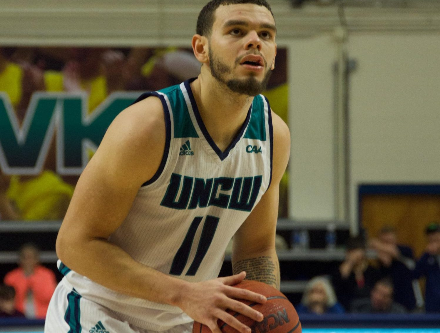 Jaylen Fornes (11) preps for a potential game-winning free throw with 12 seconds left during UNCW's matchup with Towson on Jan. 31, 2019.