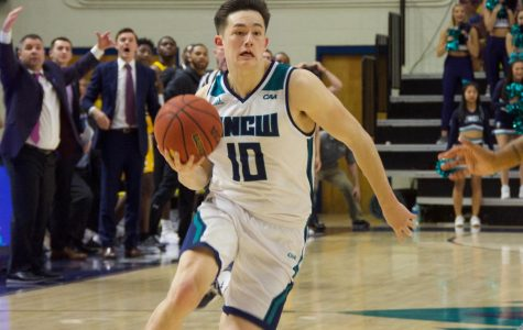 Kai Toews (10) attempts a game-winning layup during UNCW's 77-76 loss to Towson on Jan. 31, 2019.