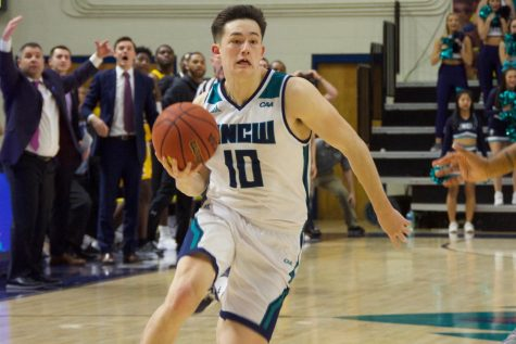 Kai Toews (10) attempts a game-winning layup during UNCW
