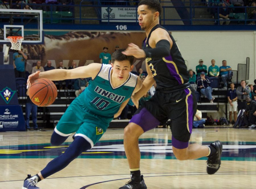 Kai Toews (10) attempts to break past a defender during UNCW's Homecoming matchup against James Madison on Feb. 2, 2019.