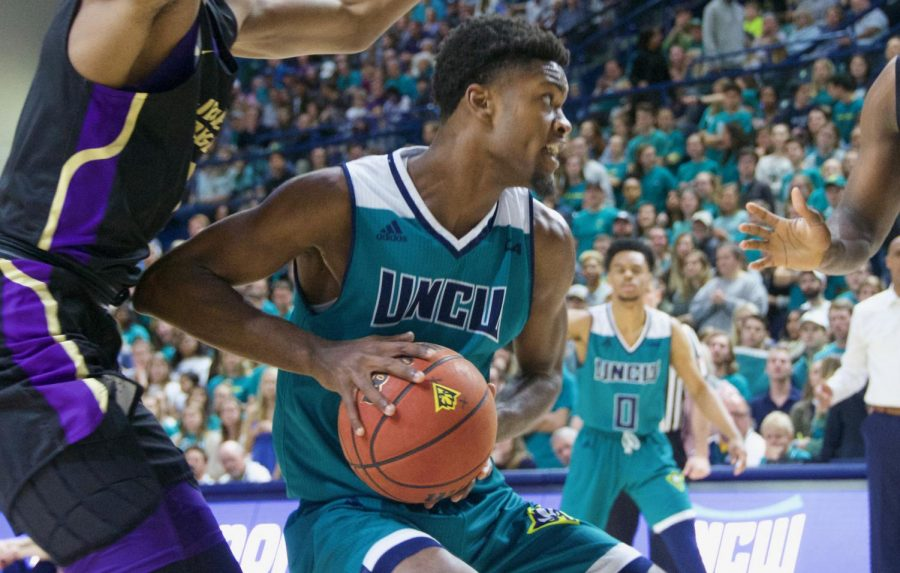 Jay Estime' (12) battles a JMU double team during UNCW's Homecoming matchup against the Dukes on Feb. 2, 2019.