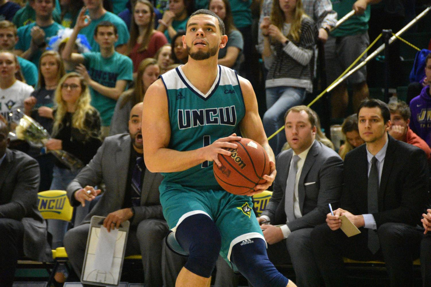 Jaylen Fornes (1) pulls up for a three-pointer during UNCW's Homecoming matchup against James Madison on Feb. 2, 2019.