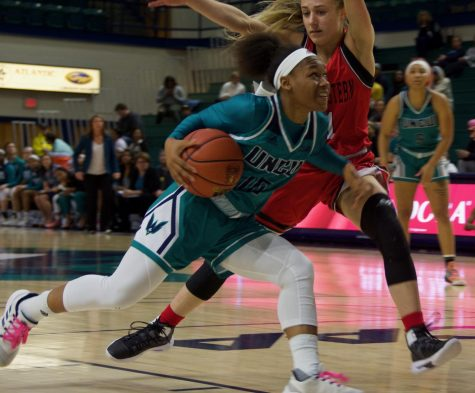 Ahyiona Vason (10) drives past a defender during UNCW
