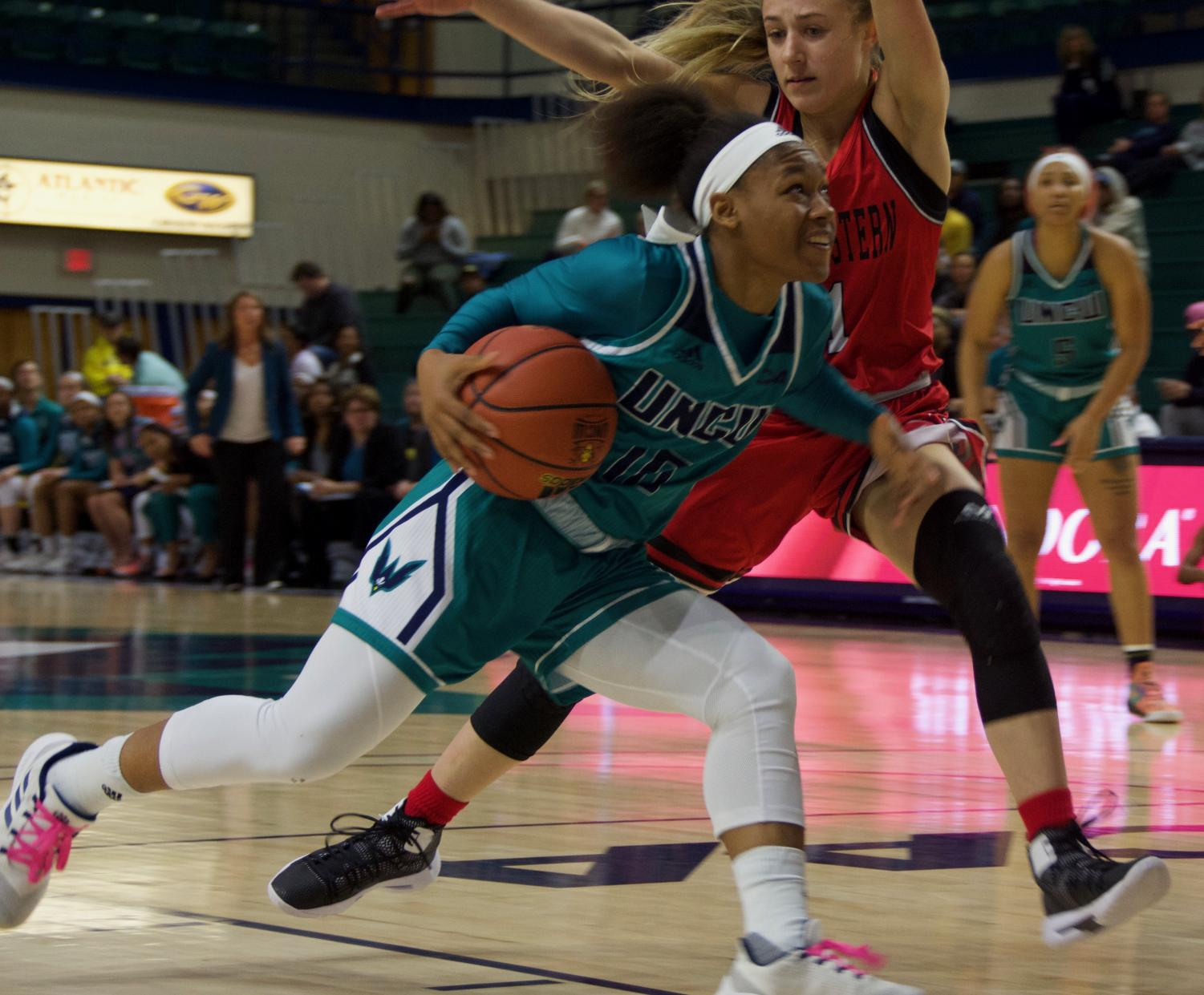 Ahyiona Vason (10) drives past a defender during UNCW's contest against Northeastern on Feb. 3, 2019.