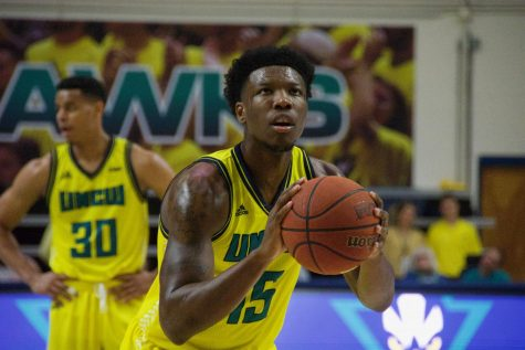 Devontae Cacok (15) attempts a free throw during UNCW