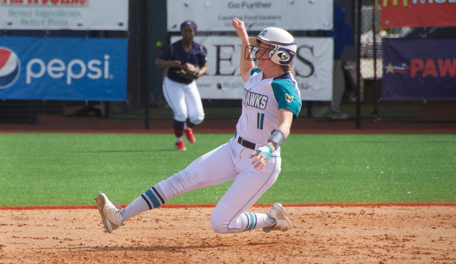 Camryn Dean (11) slides into third base during UNCW's matchup with Howard in the Fairfield Inn & Suites Seahawk Softball Bash on Feb. 15, 2019.