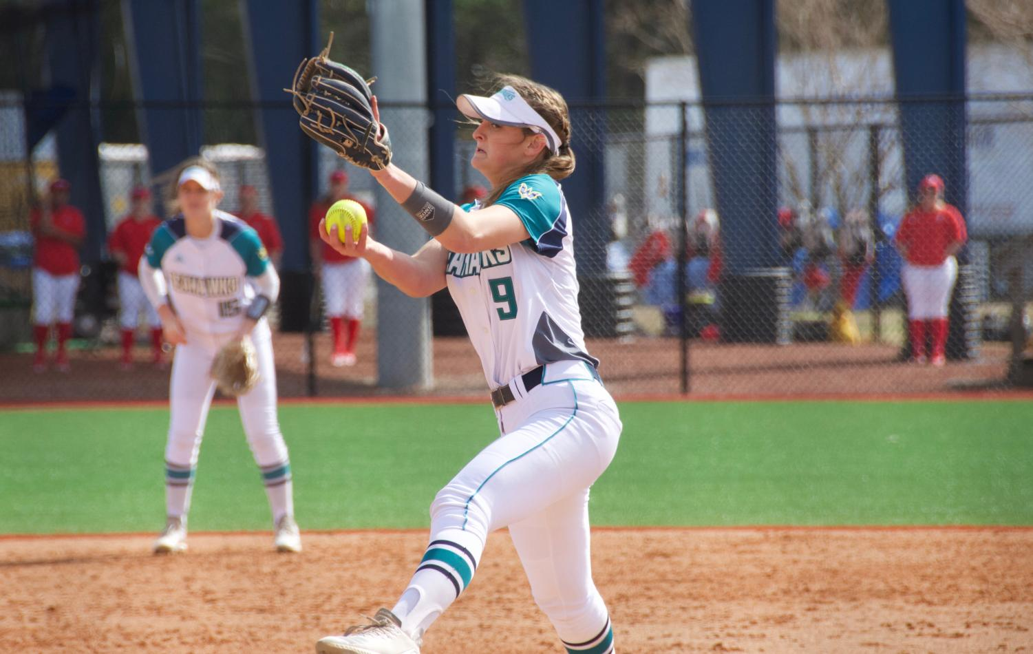 Janel Gamache (9) throws a pitch during UNCW's matchup with Howard in the Fairfield Inn & Suites Seahawk Softball Bash on Feb. 15, 2019.