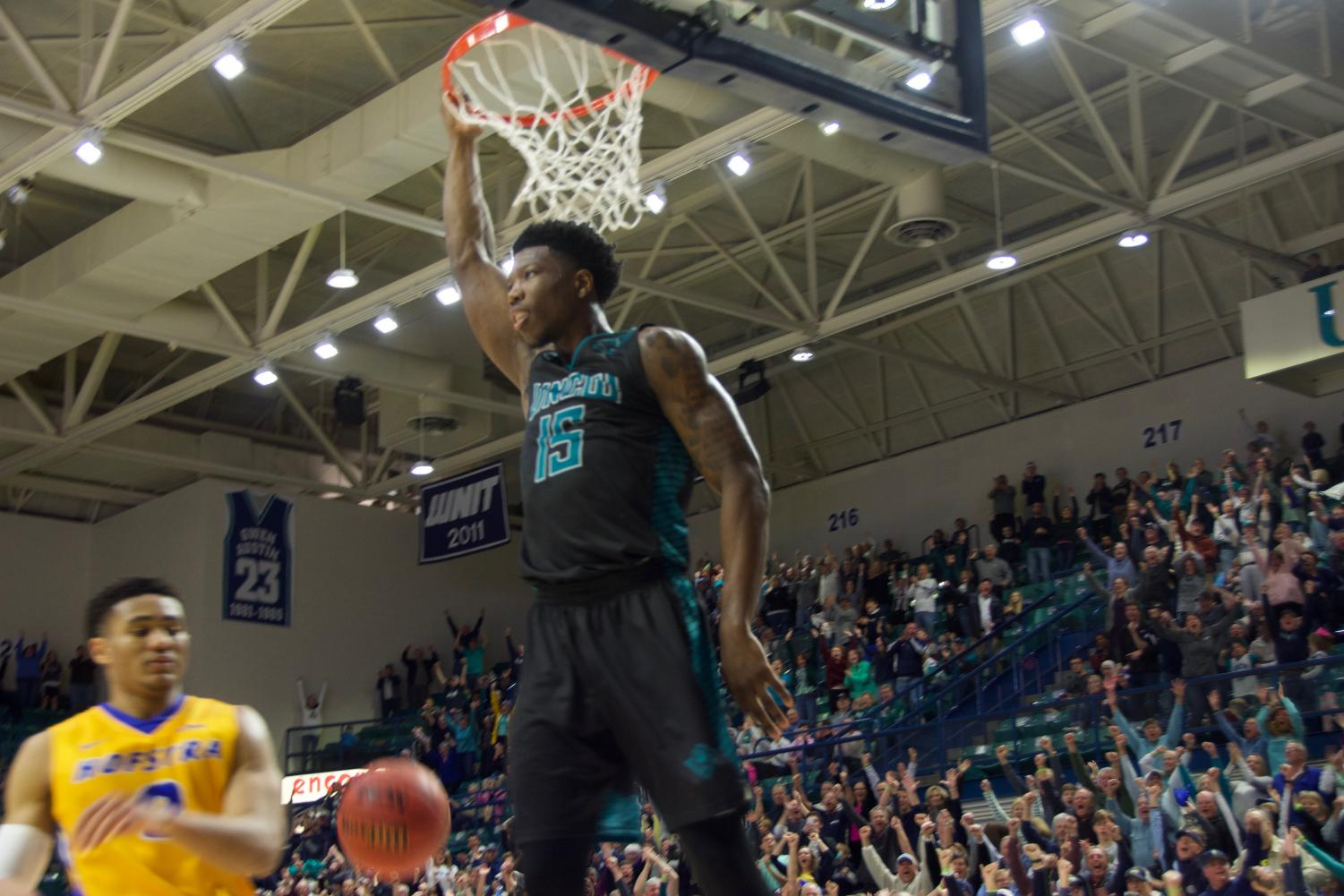 Devontae Cacok (15) delivers his final dunk in Trask Coliseum during UNCW's 87-79 Senior Day win over Hofstra on Feb. 16, 2019.