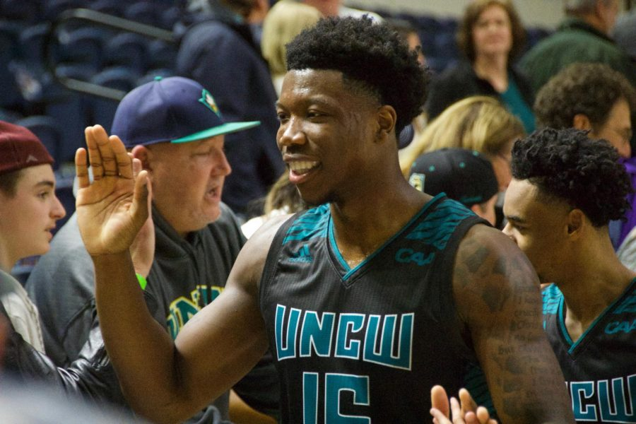 Devontae Cacok (15) celebrates with fans following UNCW