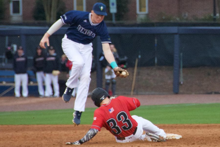 Cole Weiss (8) looks to tag out a runner to give UNCW the 5-3 win during the Seahawks' matchup with VMI on Feb. 17, 2019.