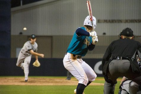 Doug Angeli (4) bats during UNCW's matchup against Coastal Carolina on Feb. 19, 2019 at Brooks Field.