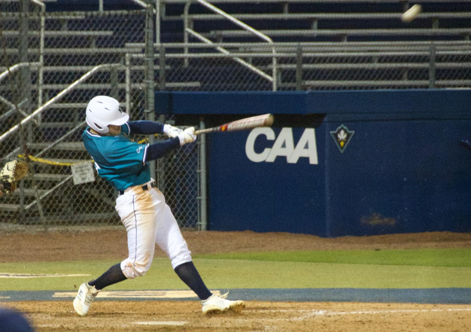 Doug Angeli (4) hits a homer during UNCW's matchup against Coastal Carolina on Feb. 19, 2019 at Brooks Field.